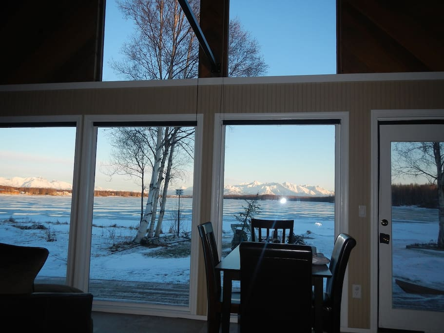 Window wall with entrance lakeside. Blackout blinds on all! Talketna range to north, Chugach east with Matinuska as the centerpiece and Pioneer peak winter view.