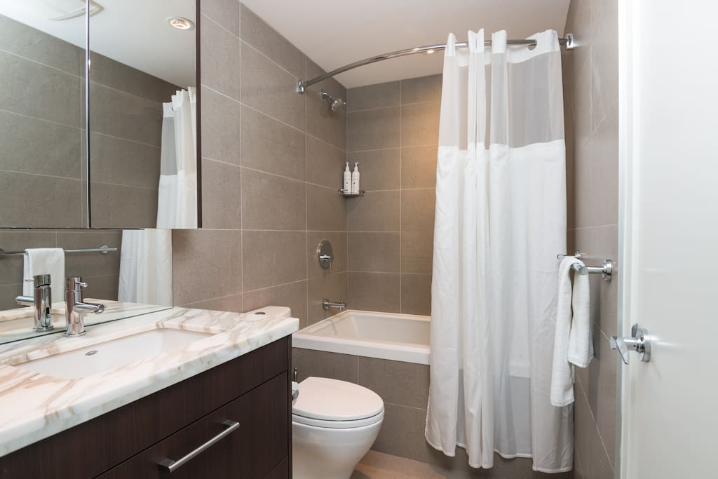 Clean bathroom with a soaker bathtub and a fantastic shower