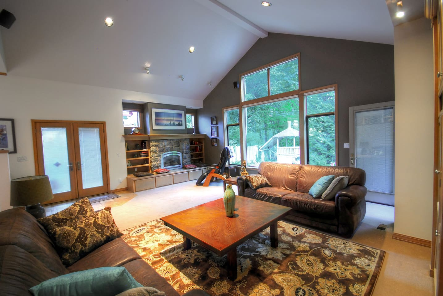 "The ""shared"" Great Room is 500 sf. Snuggle by the fire or party. Enjoy the greenbelt view and connect with nature."