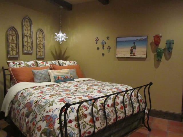 Cabo Suite with king bed, lake/pool view, en suite bath, and direct pool deck access.