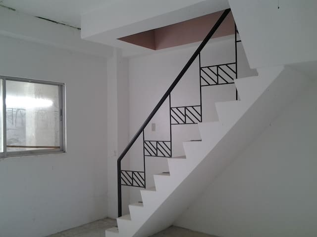 Stairs to go to 2nd floor bedrooms.