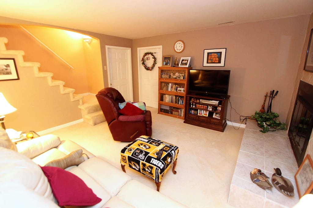 Our Lake retreat suite includes this family room, kitchenette, bathroom, hot tub and bedroom.