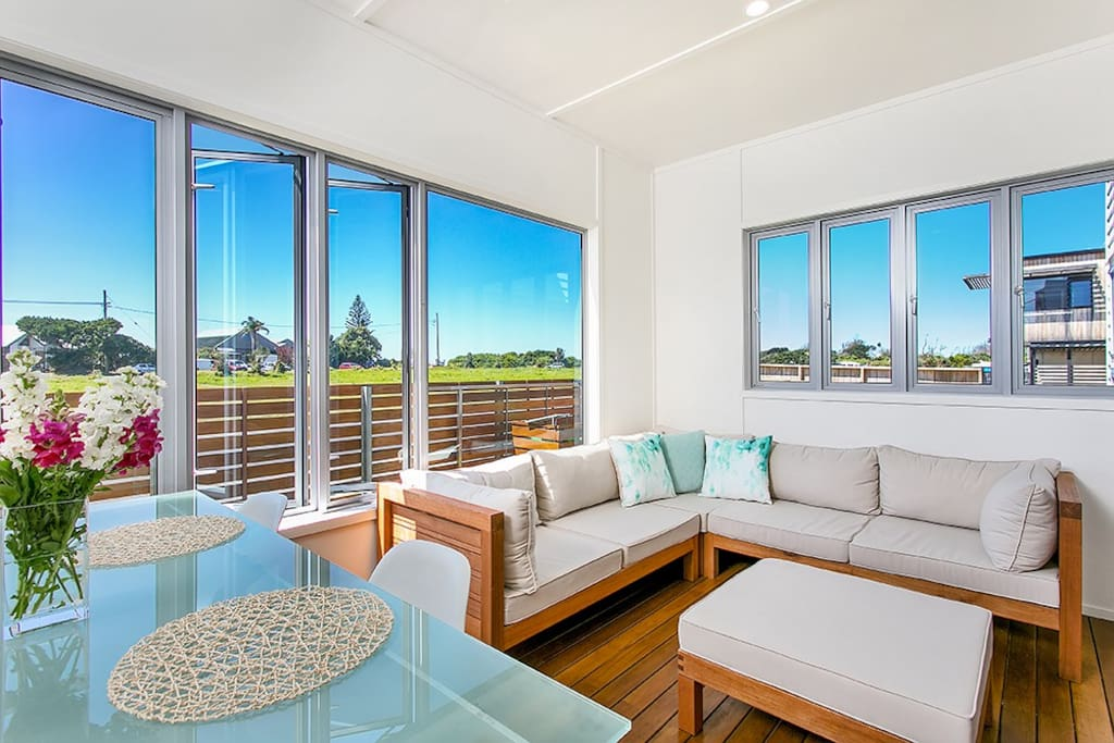Sunny enclosed deck with views up to the lighthouse.