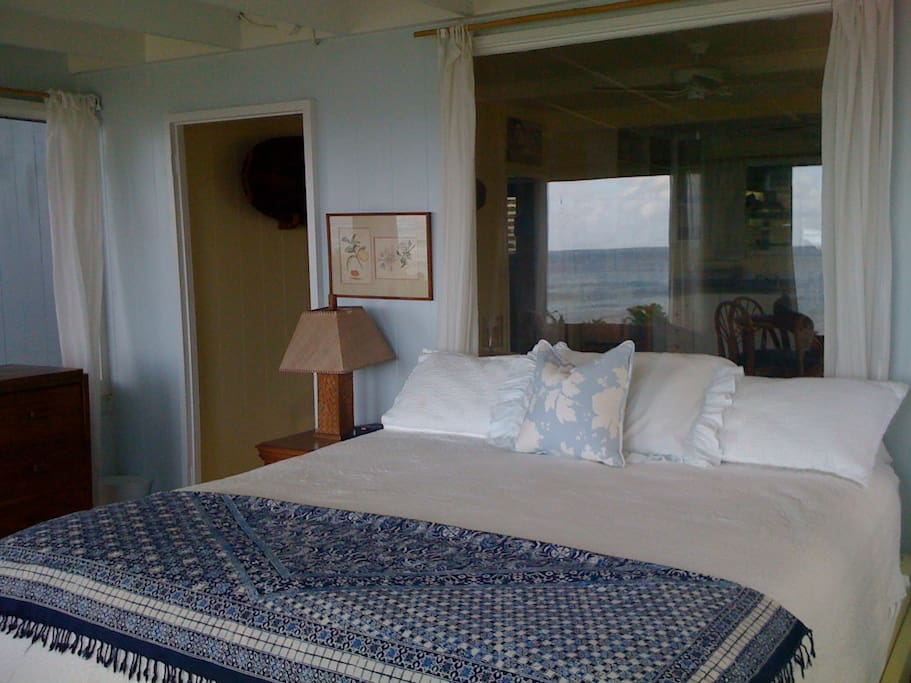 Master bedroom with King bed, windows to the ocean view