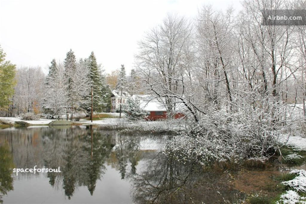 Early winter pond view with house and barn