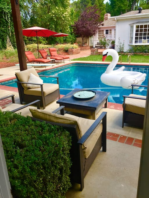 Glass firepit seating along the side of the pool.  Roast marshmellows, read, share wine, enjoy a cup of coffee!  RELAX and REGENERATE !!!!!!!!