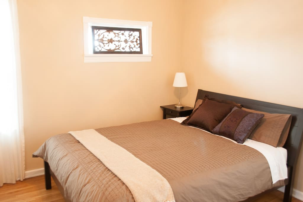 Master bedroom with comfortable queen-sized bed