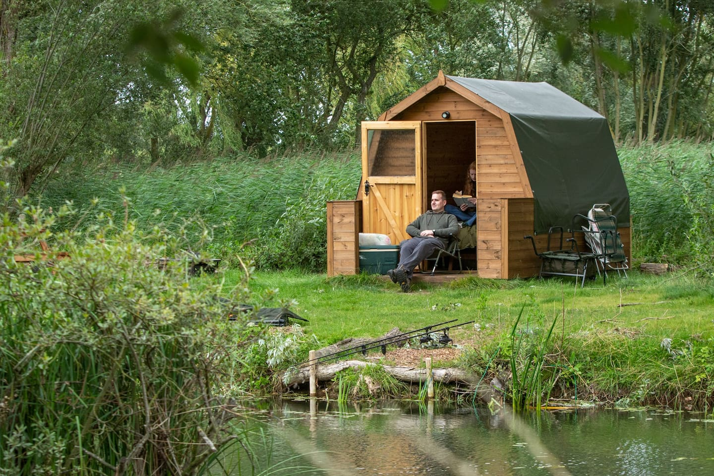 Wooden glamping pod (single, twin or double) in a secluded plot on the banks of a mature carp fishing lake.