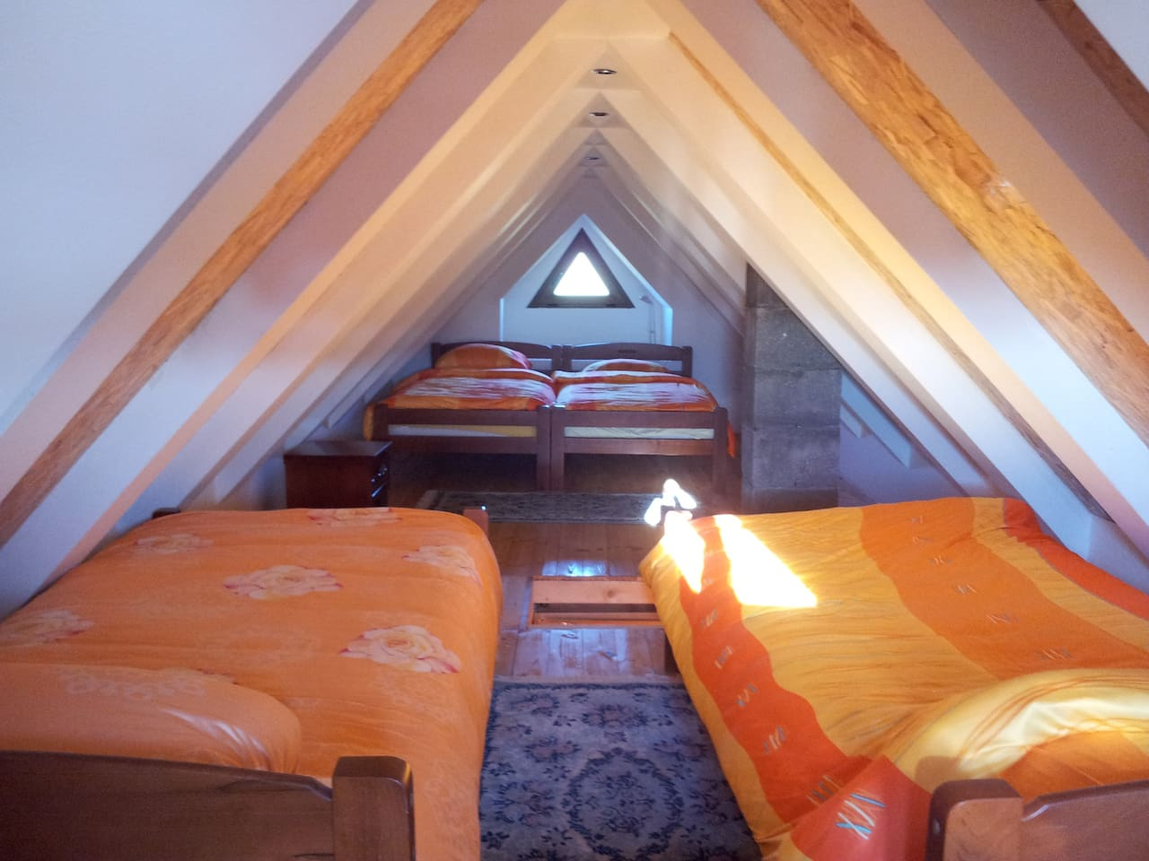 There are four comfortable beds in the attic.