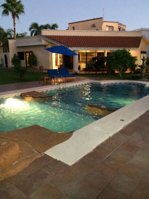 Large and spacious pool and garden setting.