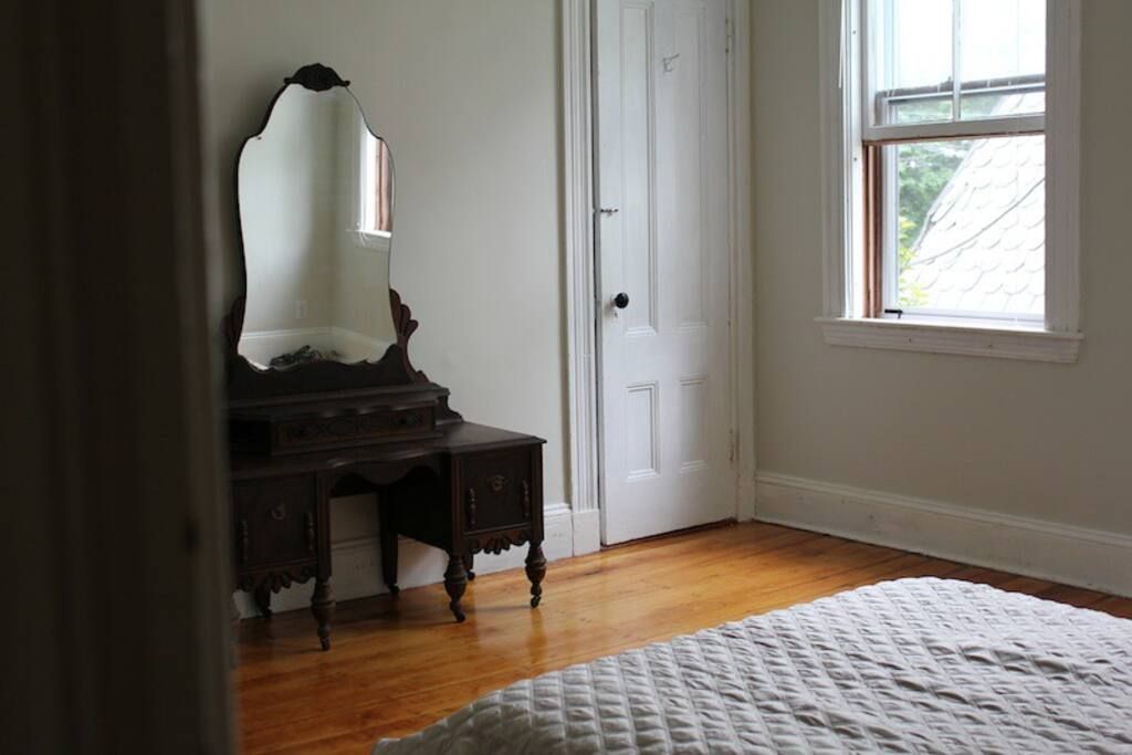 this room: two antique dressers, a large closet, queen size bed and two big windows
