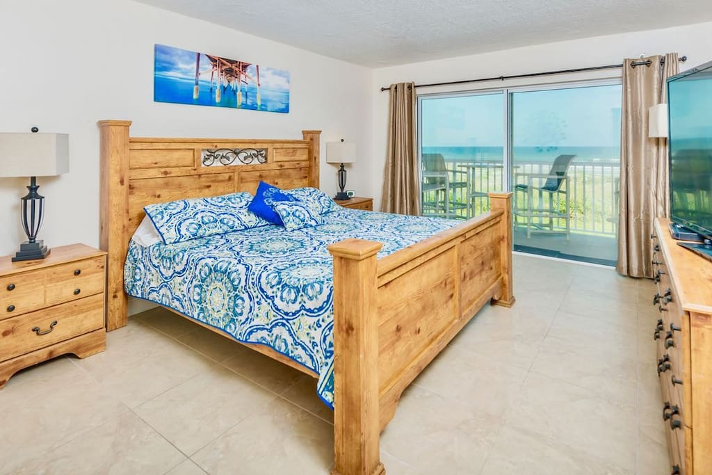 Master bedroom directly facing the ocean has both a king bed and big screen TV.