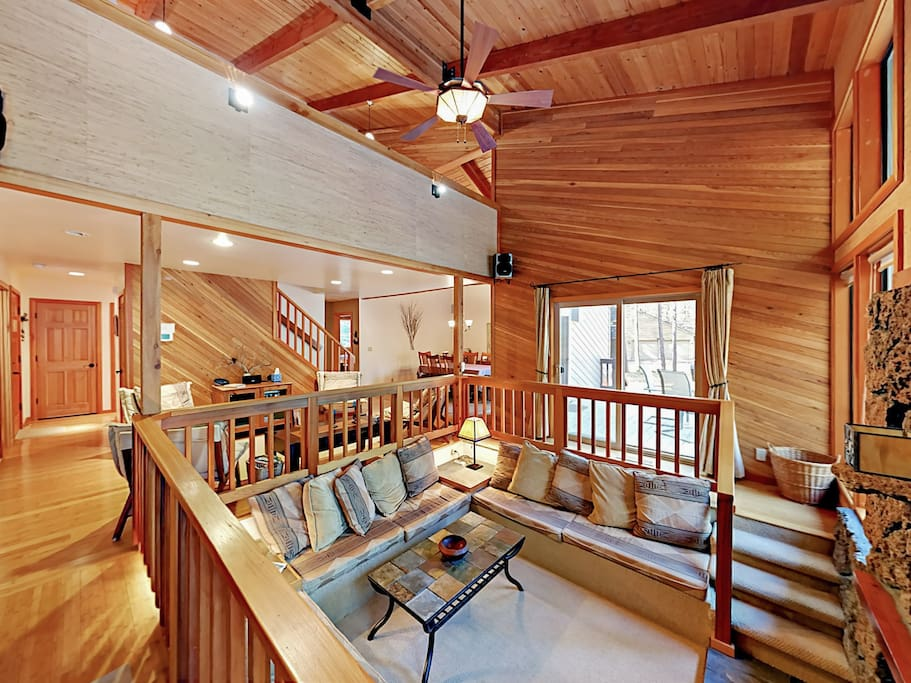 Spacious living area with vaulted ceilings, huge picture windows, and 2 sitting areas.