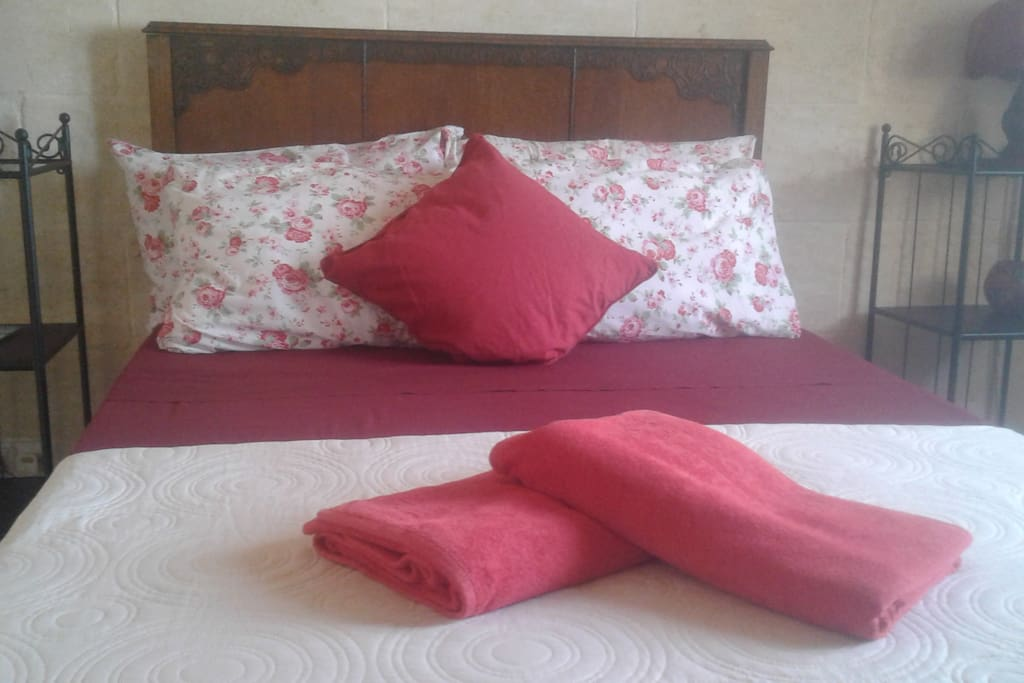 Cosy double bed with beach towels