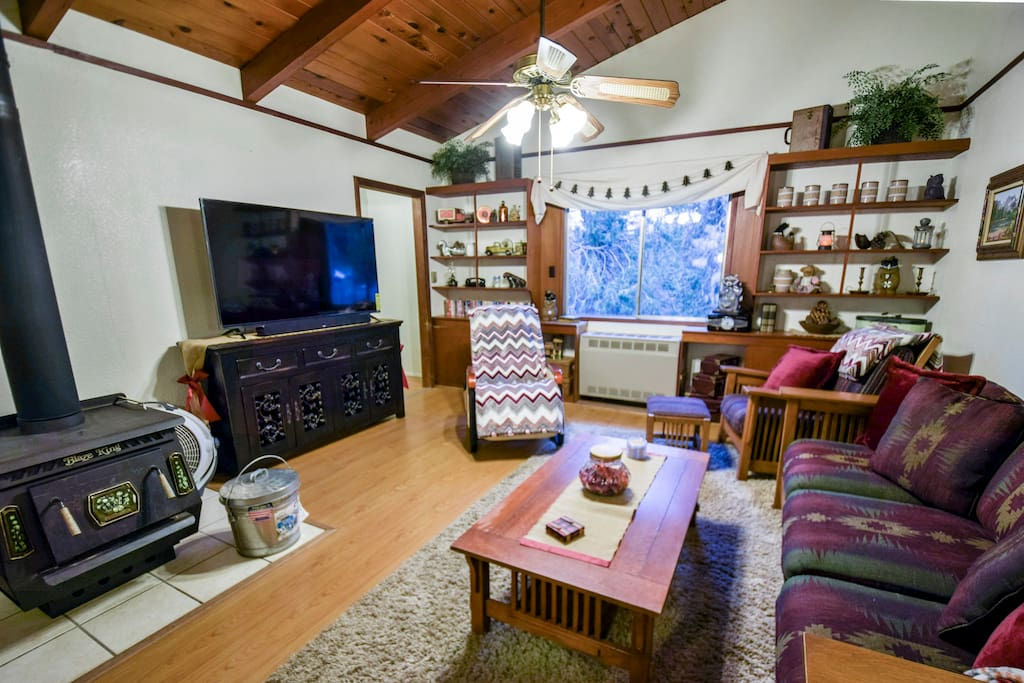 "Living room with fireplace and propane wall heater, new 60"" Smart TV, games, kid's corner & more!"