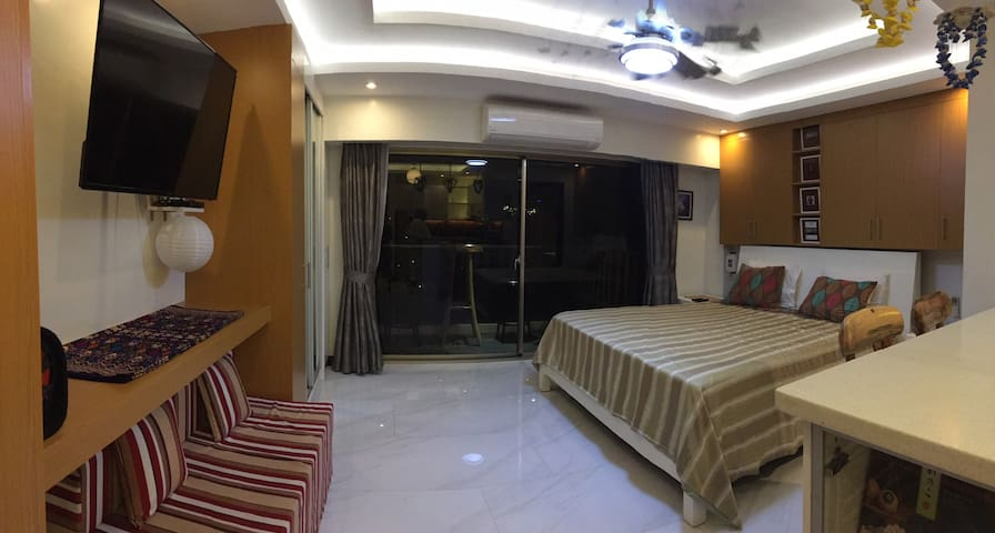 king size bed, Queen size couch bed for guests and sliding glass doors to private balcony overlooking pool