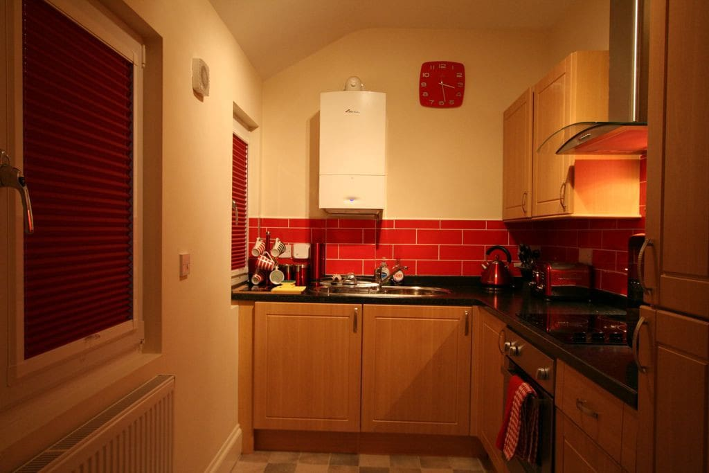 Full kitchen with fridge/freezer, electric hob and cooker, washing machine.