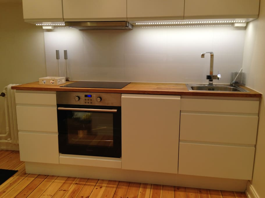 Modern kitchen with oven, micro and dishwasher.