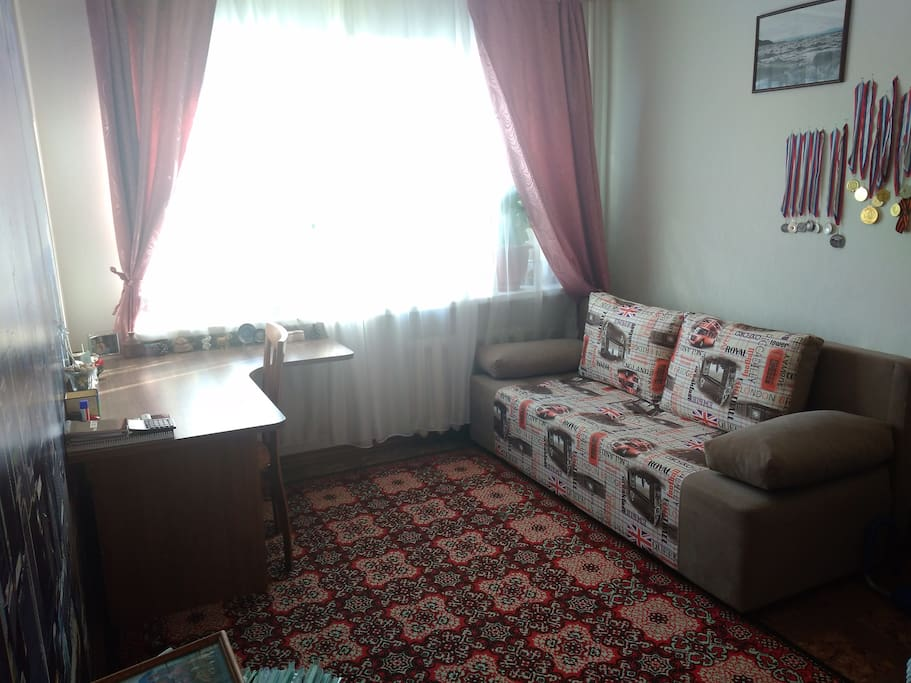 The first room has a sofa, table, chairs