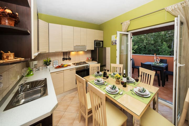 FULLY EQUIPPED KITCHEN - DINNING AREA OPENED TO  THE COVERED TERRACE