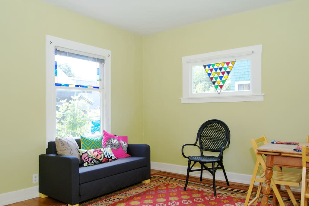 Living room has a small fold out couch suitable for one adult or two kids.