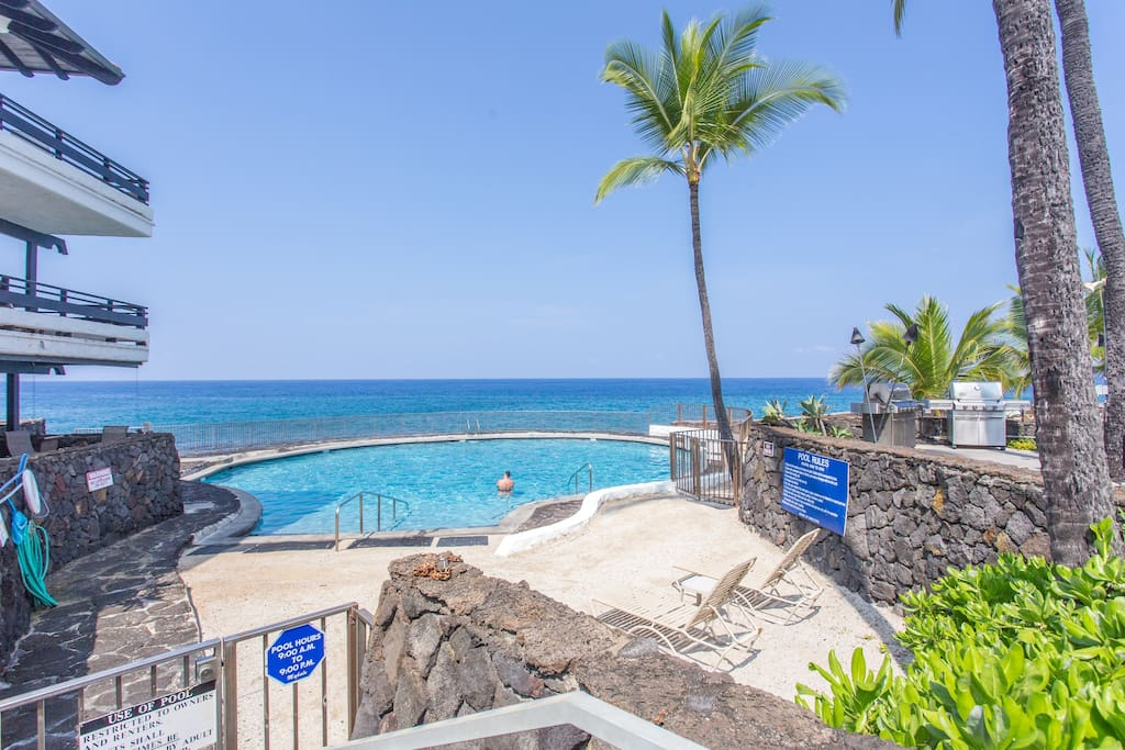 Steps away from the condo is a pool overlooking the ocean.