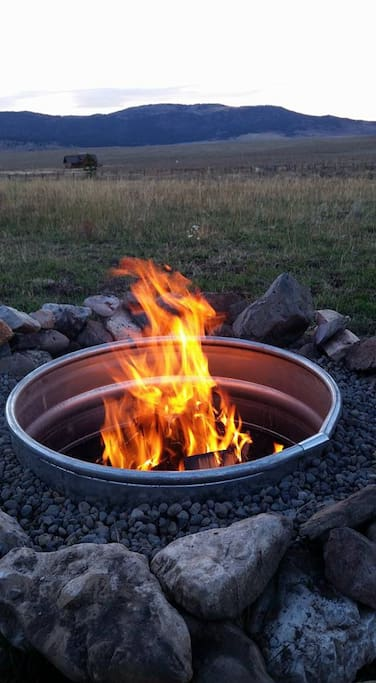 Enjoy sitting by the fire and enjoy the views. There is also a stand-up grill to cook on outside.
