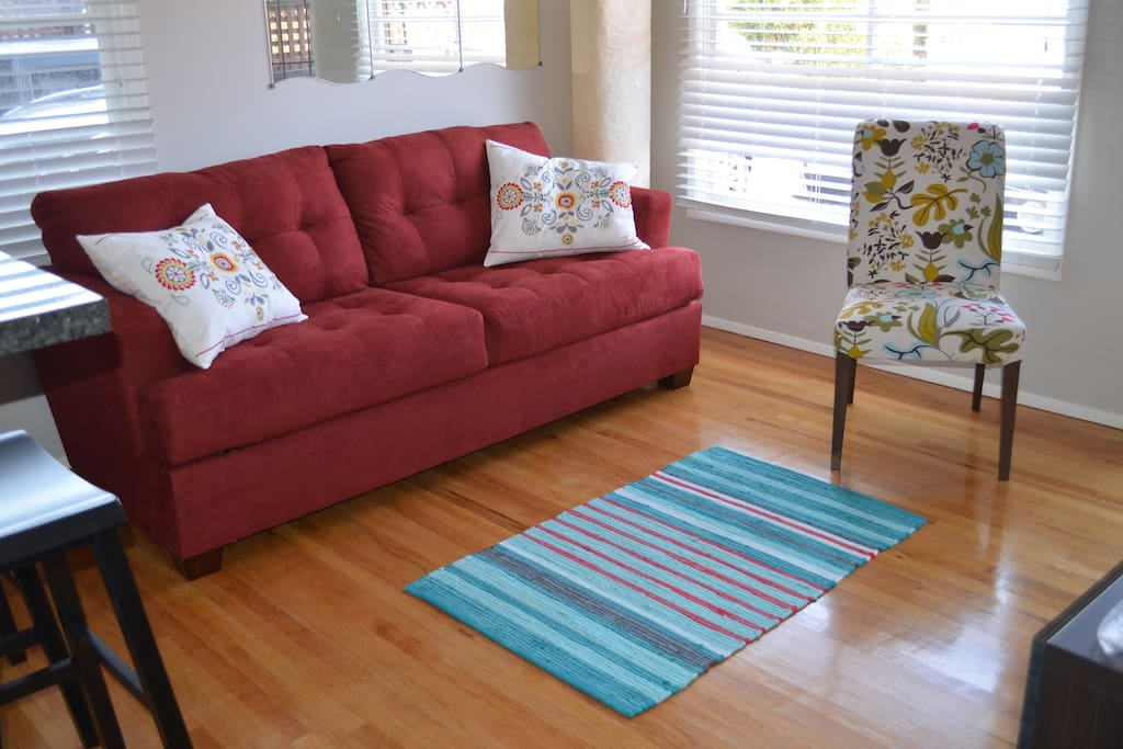 Bright and cheery living room with queen size sleeper sofa