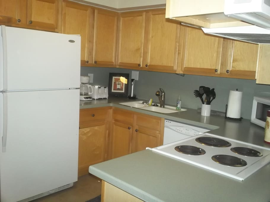 Full service kitchen including dishwasher, stove/oven, refrigerator with ice maker, toaster, coffee maker, blender, and mircrowave.