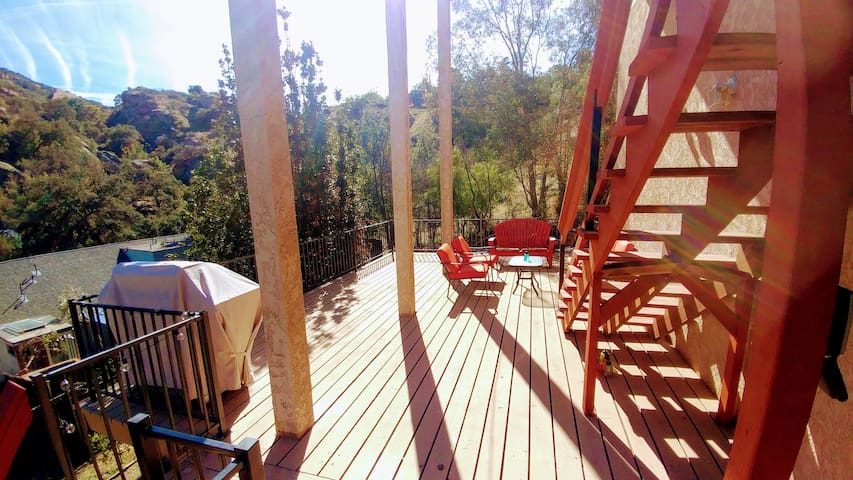 HUGE deck with seating area and BBQ