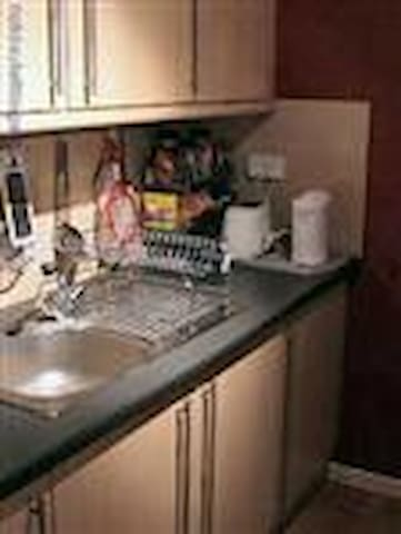 Actually this is not a good photo of the kitchen which is a galley kitchen and fully equipped.