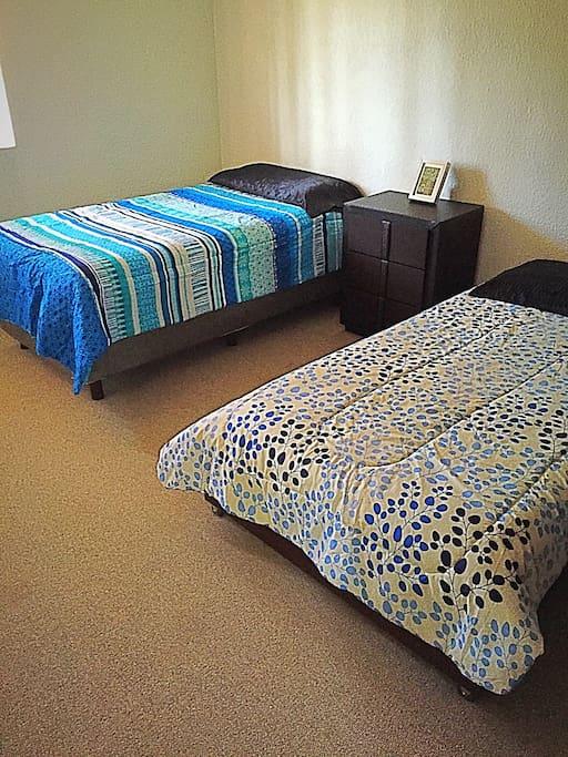 Bedroom with fridge, flatscreen, Apple TV & closet space
