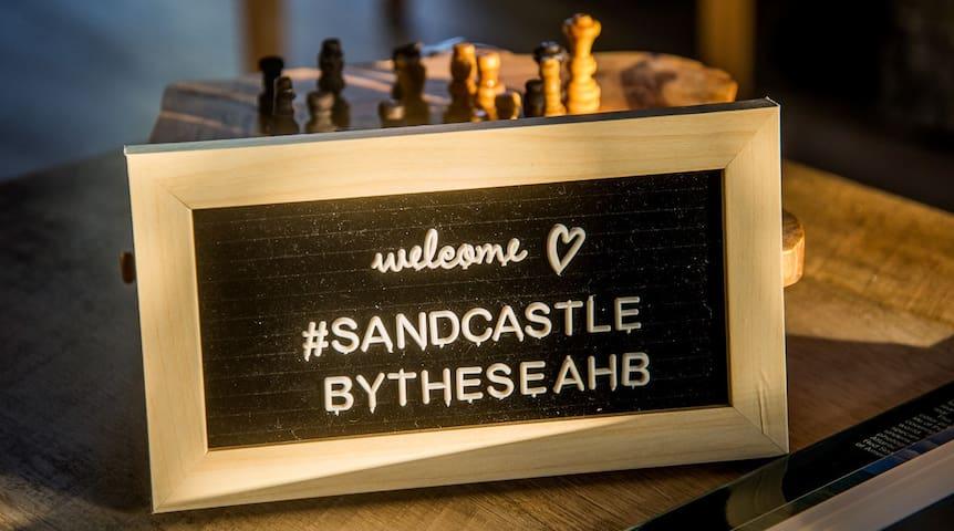 Our Hashtag!  #SandcastleByTheSeaHB