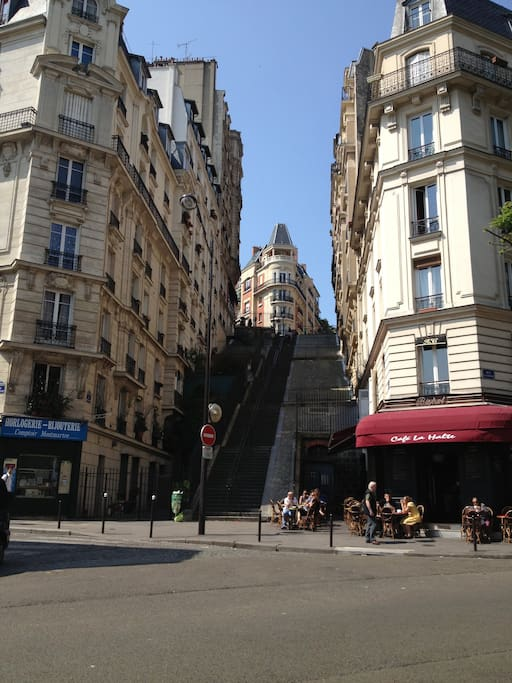 Up the street are the stairs to be on Montmartre's Hill and the Sacré Coeur Basilica.