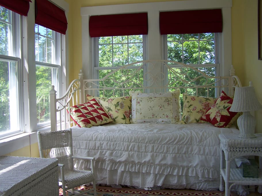 The Spring room's sun porch with a twin daybed.