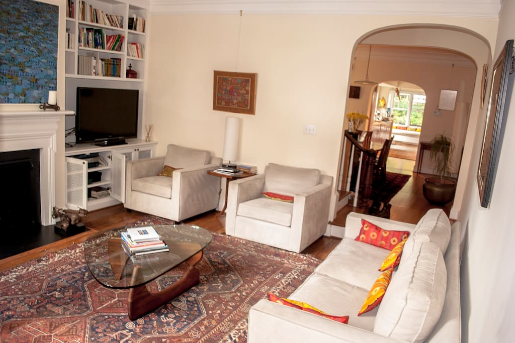 a large flat screen TV, and comfortable living room