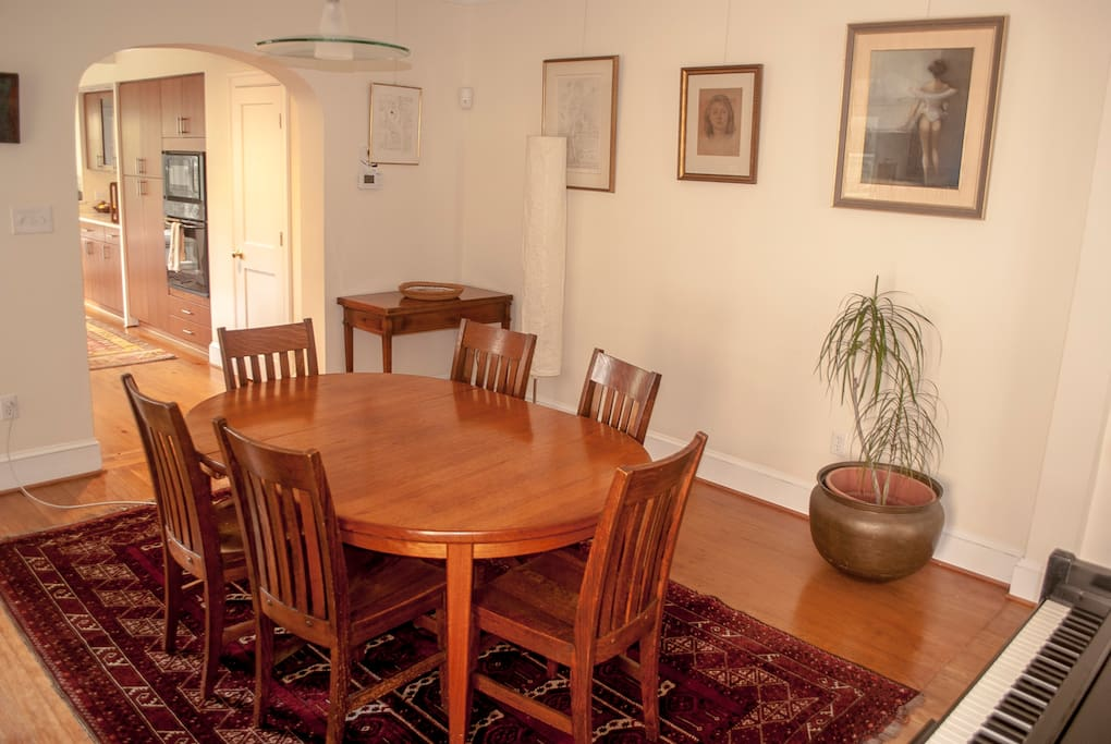 dining room with upright piano