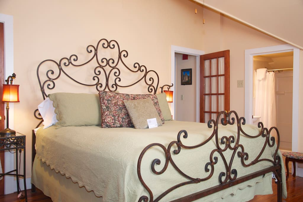 King wrought iron bed in our suite that sleeps up to 5 guests.