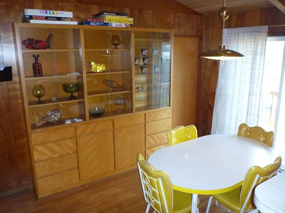 Built in cupboards in the dining area house games & puzzles as well as some great period decor