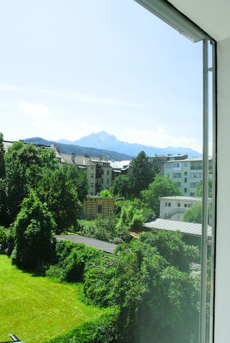 view to a green courtyard and mountains