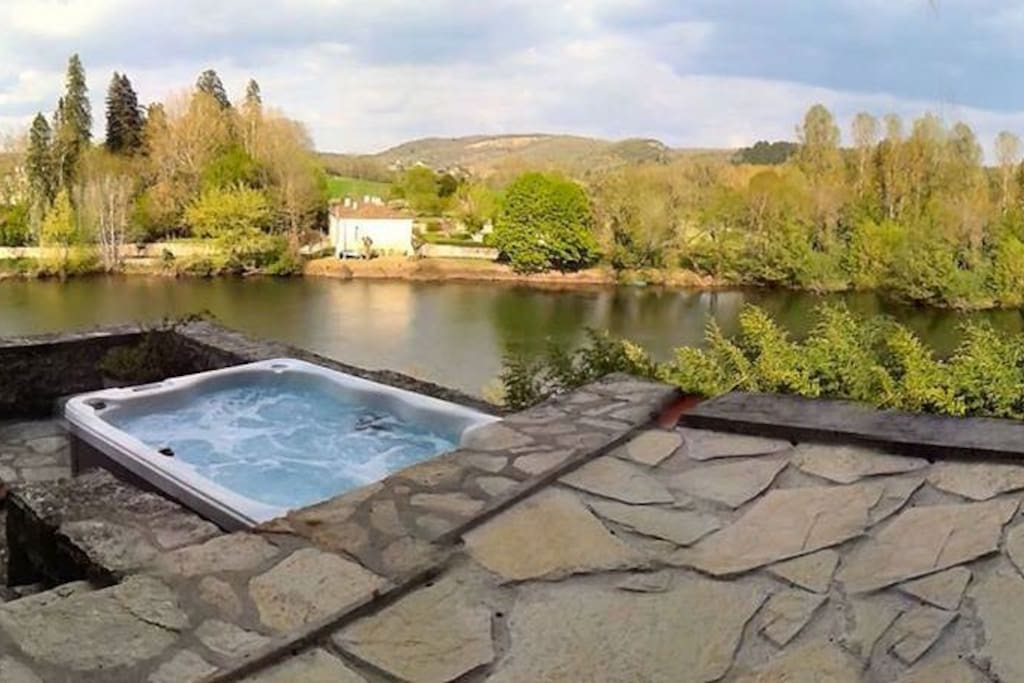 Hot tub jacuzzi with spectacular views of River Lot
