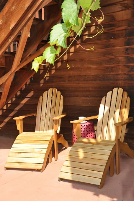 Adirondack chairs next to the front door.