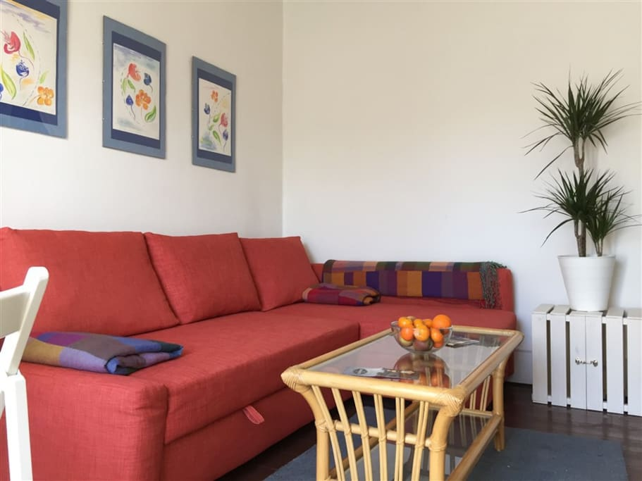 The freshly decorated living room has a comfortable double sofa bed (sleeps 2)