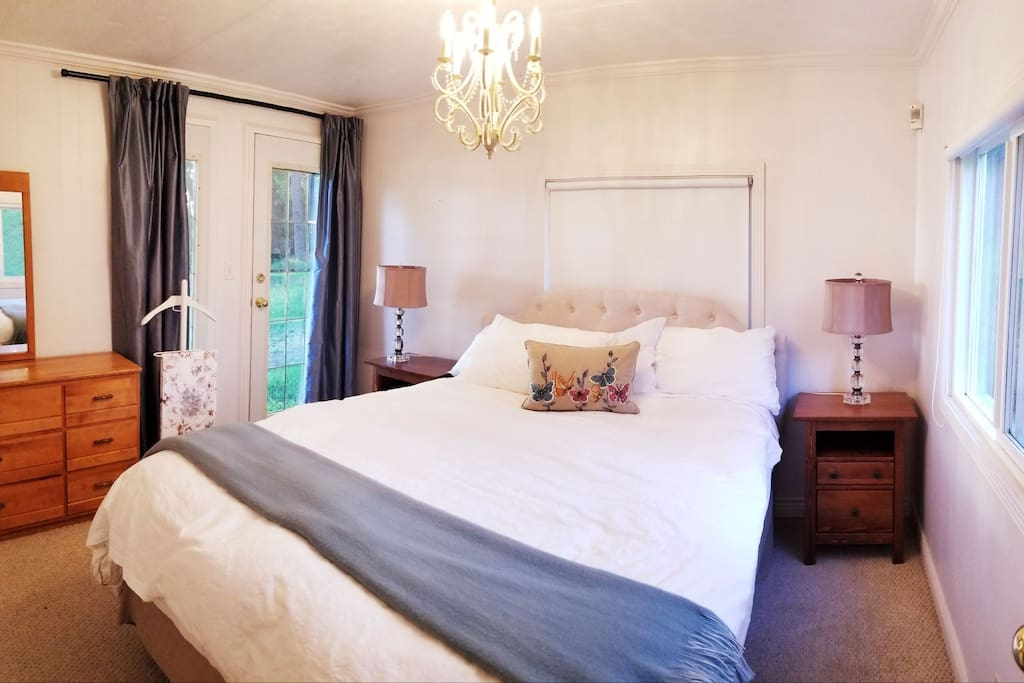 Master bedroom with brand new luxurious sheets and duvet. Door opens right onto front porch