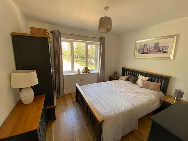 King size bed, wardrobe, cupboard and chest of drawers