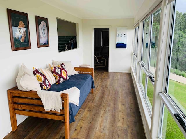 Sunroom with magnificent views. Has a day bed with a single size mattress for additional guests.