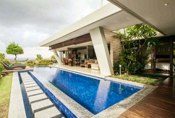 Our villa with open and modern concept in Jimbaran hill with breathing view and private swimming pool ( 12 metres x 4 metres swimming pool size)