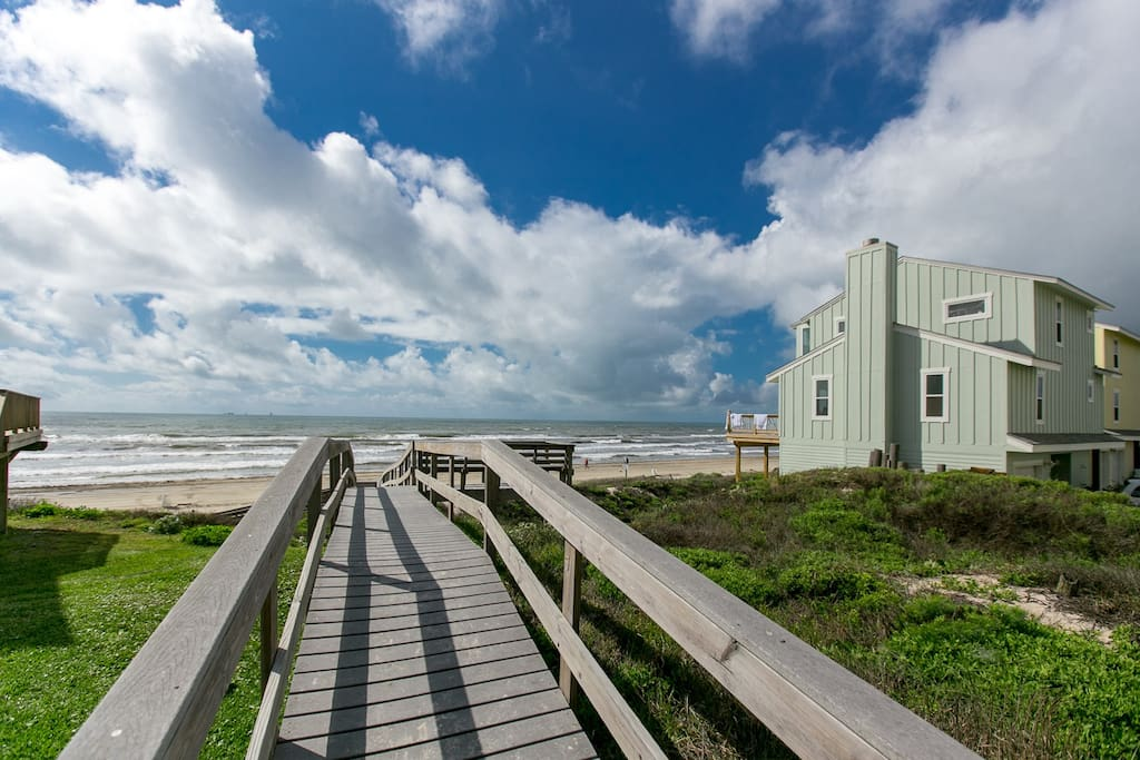 A private boardwalk leads straight to the secluded beach.
