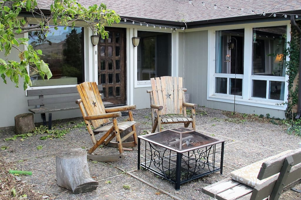 Front Patio with rocking chairs and a firepit for you to use