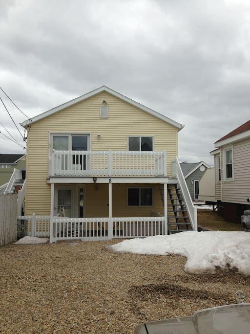 Front of cottage with top deck
